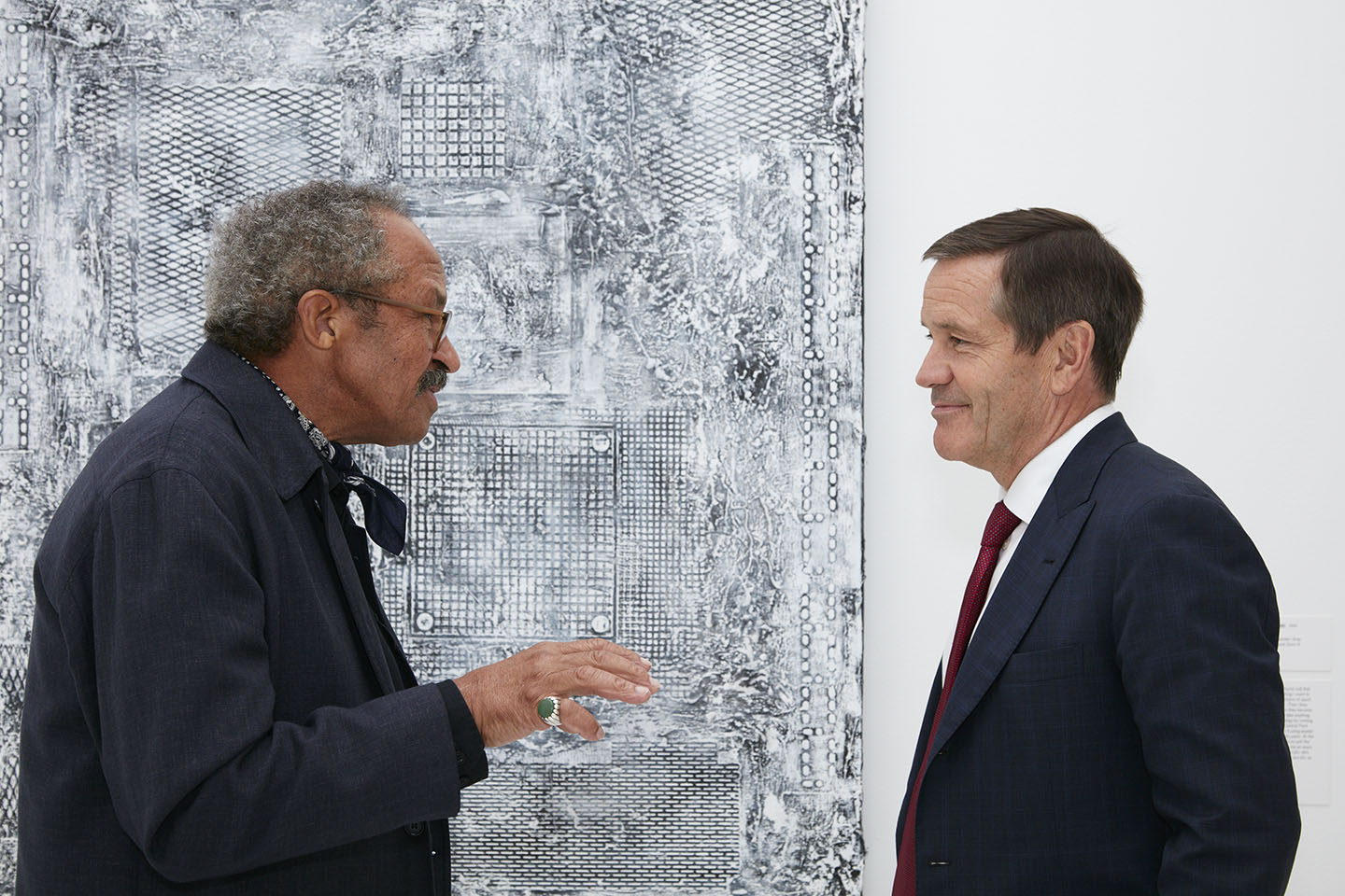 Taft with Jack Whitten, a preeminent African American painter, next to his work Garden in Bessemer. One of Taft's passions is collecting contemporary art, such as this work which he owns, and he serves on the Andy Warhol Foundation board. Gene Pittman
